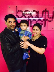 Nazia with her husband and first child!